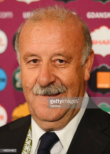 In this handout image provided by UEFA Coach Vicente del Bosque of Spain talks to the media after the UEFA EURO 2012 Group C match between Spain and...