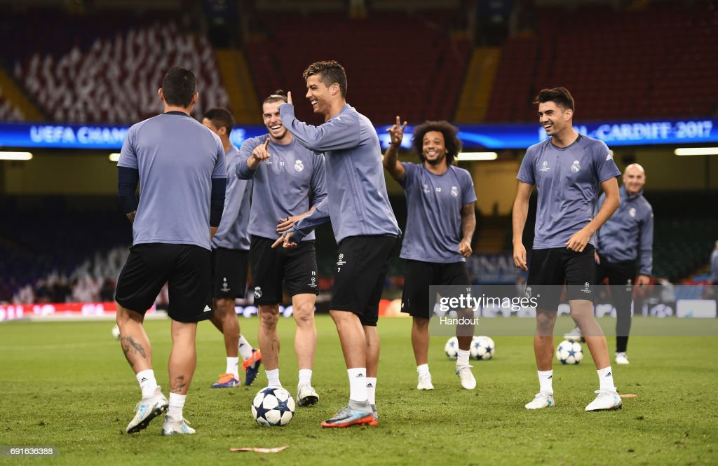 In this handout image provided by UEFA, Cristiano Ronaldo of Real Madrid shares a joke with team mates Gareth Bale and Marcelo during a training session prior to the UEFA Champions League Final between Juventus and Real Madrid at the National Stadium of Wales on June 2, 2017 in Cardiff, Wales.