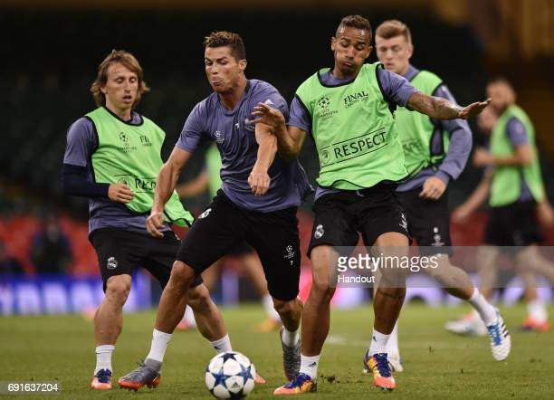 In this handout image provided by UEFA Cristiano Ronaldo of Real Madrid and Danilo of Real Madrid battle for possession during a Real Madrid training...