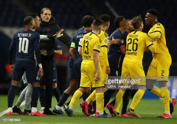 In this handout image provided by UEFA DanAxel Zagadou of Borussia Dortmund clashes with players of Paris SaintGermain as Lukasz Piszczek of Borussia...