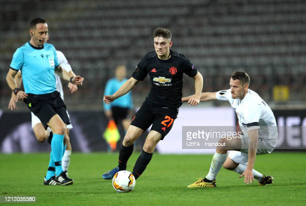In this handout image provided by UEFA Daniel James of Manchester United is challenged by Christian Ramsebner of LASK during the UEFA Europa League...