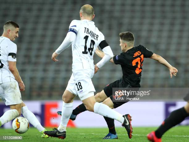 In this handout image provided by UEFA Daniel James of Manchester United scores his team's second goal during the UEFA Europa League round of 16...