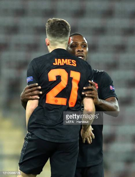 In this handout image provided by UEFA Daniel James of Manchester United celebrates with Odion Ighalo after scoring his team's second goal during the...