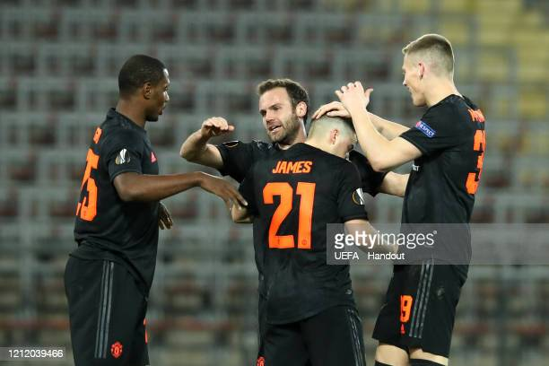 In this handout image provided by UEFA Daniel James of Manchester United celebrates with Odion Ighalo Juan Mata and Scott McTominay after scoring his...