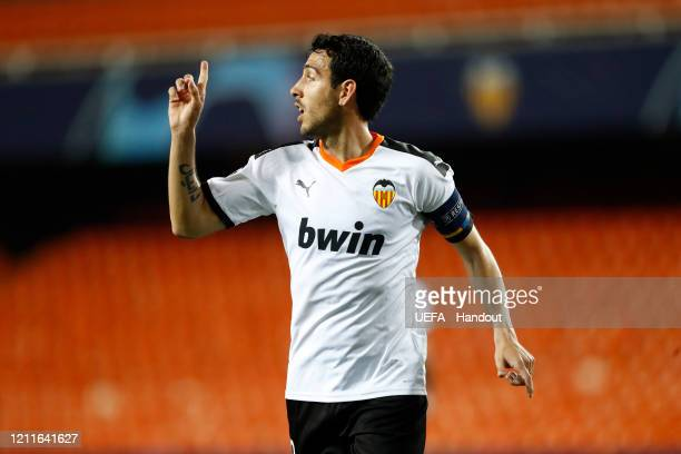 In this handout image provided by UEFA Daniel Parejo of Valencia during the UEFA Champions League round of 16 second leg match between Valencia CF...