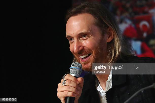 In this handout image provided by UEFA David Guetta UEFA EURO 2016 Music Ambassador attends the UEFA EURO 2016 Kick Off press conference at Stade de...