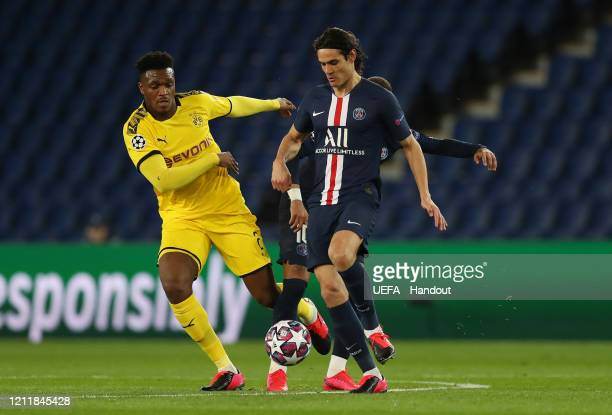 In this handout image provided by UEFA Edinson Cavani of Paris SaintGermain is challenged by DanAxel Zagadou of Borussia Dortmund during the UEFA...