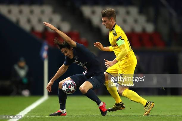 In this handout image provided by UEFA Edinson Cavani of Paris SaintGermain is challenged by Lukasz Piszczek of Borussia Dortmund during the UEFA...