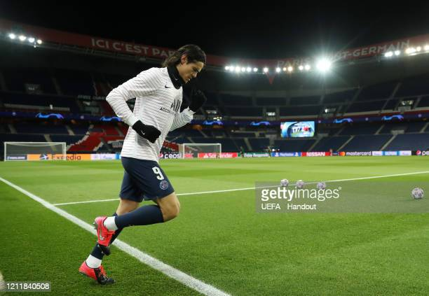 In this handout image provided by UEFA Edinson Cavani of Paris SaintGermain runs out to warm up prior to the UEFA Champions League round of 16 second...