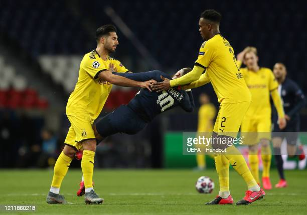 In this handout image provided by UEFA Emre Can of Borussia Dortmund pushes Neymar of Paris SaintGermain and is later sent off during the UEFA...