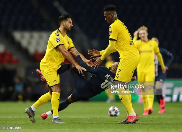 In this handout image provided by UEFA, Emre Can of Borussia Dortmund pushes Neymar of Paris Saint-Germain and is later sent off during the UEFA...