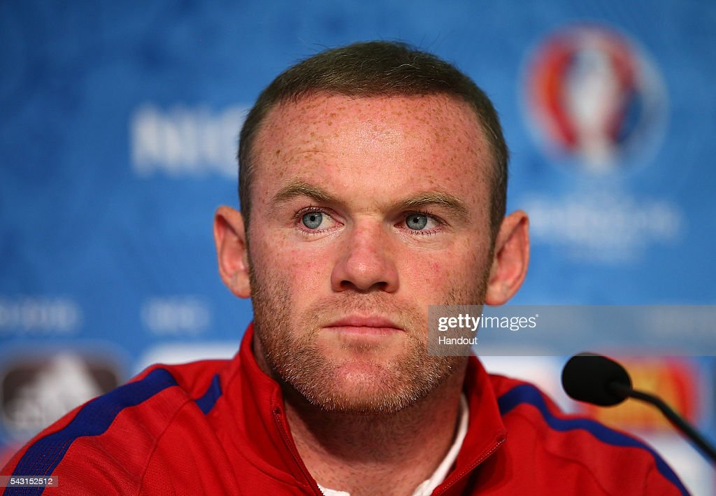 In this handout image provided by UEFA, England Captain Wayne Rooney faces the media during the England press conference at Allianz Riviera Stadium on June 26, 2016 in Nice, France.