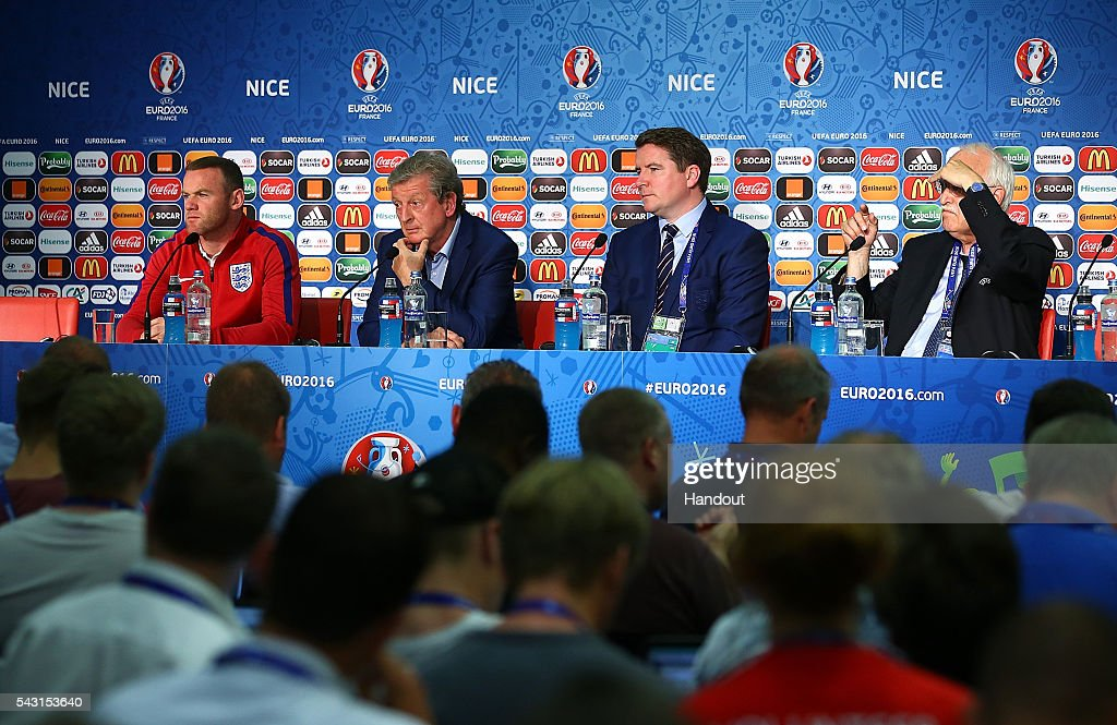In this handout image provided by UEFA, England Captain Wayne Rooney (L) and England manager Roy Hodgson (2L) face the media during the England press conference at Allianz Riviera Stadium on June 26, 2016 in Nice, France.
