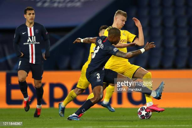 In this handout image provided by UEFA Erling Haaland of Borussia Dortmund battles for possession with Presnel Kimpembe of Paris SaintGermain during...