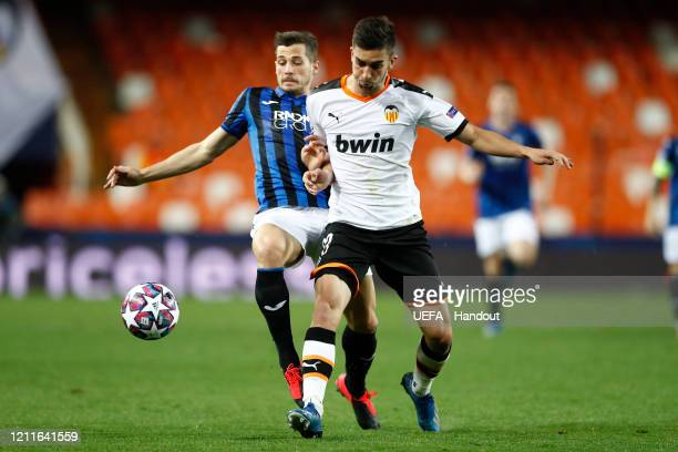 In this handout image provided by UEFA Ferran Torres of Valencia is closed down during the UEFA Champions League round of 16 second leg match between...