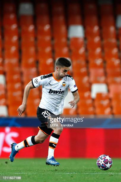 In this handout image provided by UEFA Ferran Torres of Valencia runs with the ball during the UEFA Champions League round of 16 second leg match...