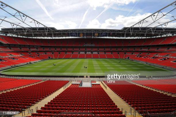 In this handout image provided by UEFA final preparations are made to the pitch at Wembley Stadium for the Champions League Final May 24 2011 in...