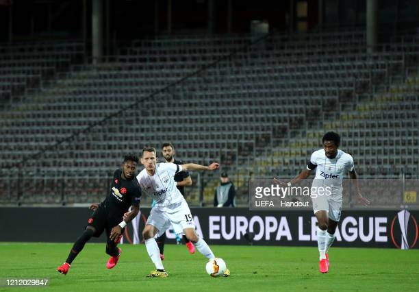 In this handout image provided by UEFA Fred of Manchester United battles for possession with Christian Ramsebner of LASK during the UEFA Europa...