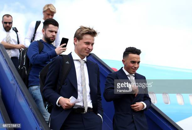 In this handout image provided by UEFA Frenkie de Jong and Abdelhak Nouri of Ajax arrive with team mates ahead of the UEFA Europa League Final...
