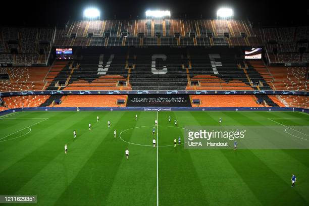 In this handout image provided by UEFA, General view as the match kicks off in an empty stadium ahead of the UEFA Champions League round of 16 second...