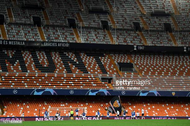 In this handout image provided by UEFA General view inside the empty stadium during the UEFA Champions League round of 16 second leg match between...