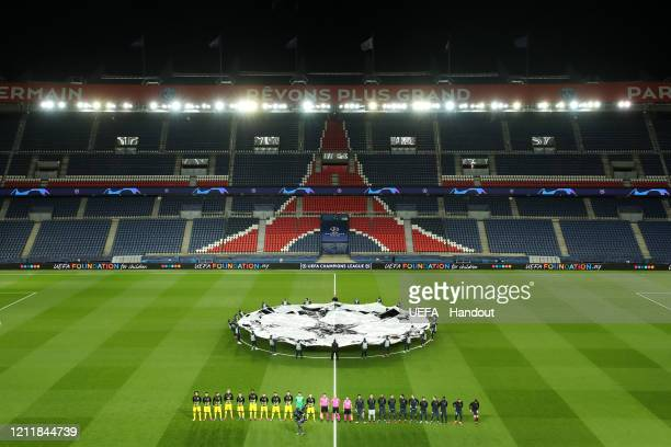 In this handout image provided by UEFA, General view inside the empty stadium as the two teams line up prior to the UEFA Champions League round of 16...