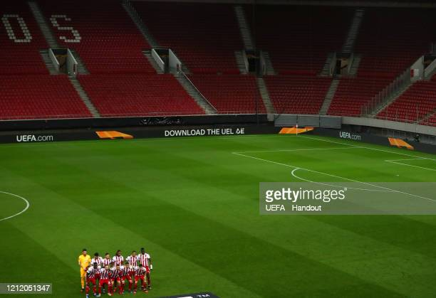 In this handout image provided by UEFA General view of empty seats as the Olympiacos FC team pose for a team photo prior to the UEFA Europa League...