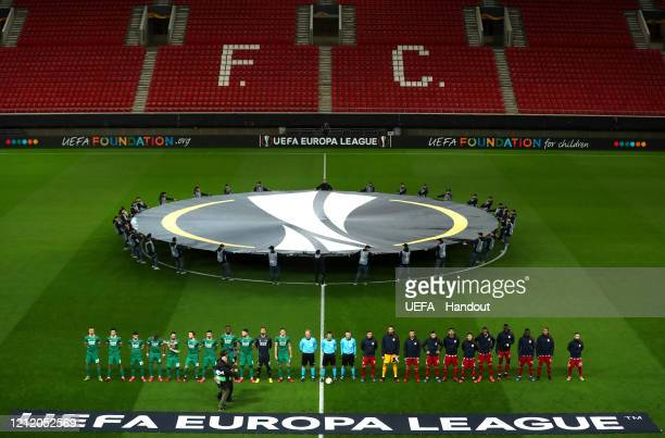 In this handout image provided by UEFA, General view of empty seats as the teams line up prior to the UEFA Europa League round of 16 first leg match...