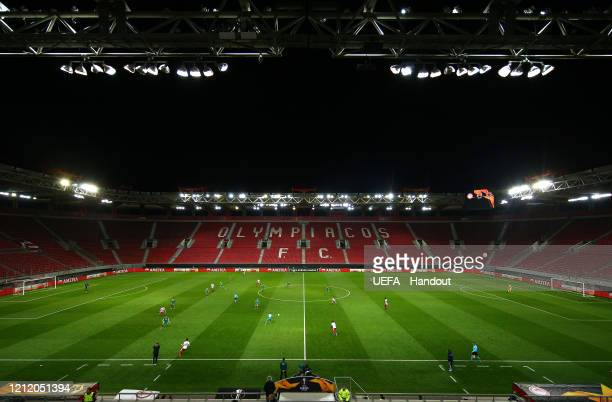 In this handout image provided by UEFA, General view of empty seats during the UEFA Europa League round of 16 first leg match between Olympiacos FC...