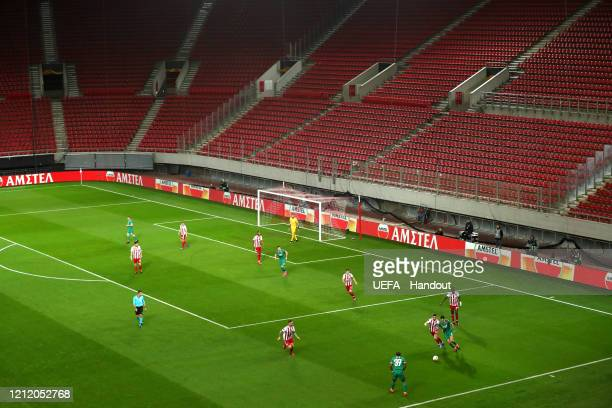 In this handout image provided by UEFA General view of empty seats during the UEFA Europa League round of 16 first leg match between Olympiacos FC...