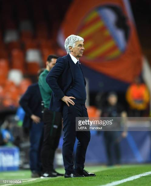 In this handout image provided by UEFA, Gian Piero Gasperini, Manager of Atalanta looks on during the UEFA Champions League round of 16 second leg...