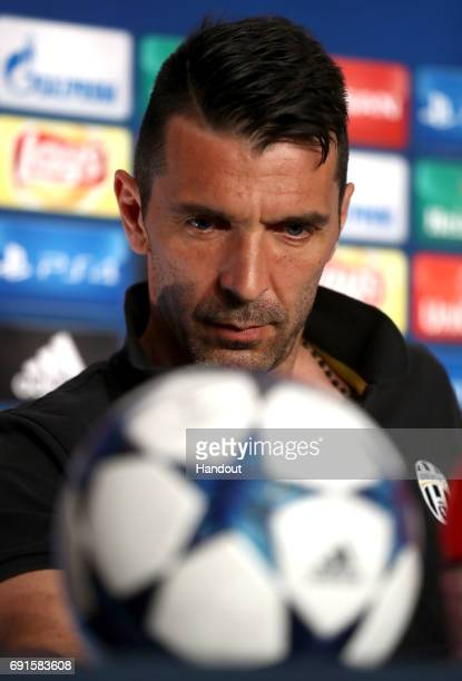 In this handout image provided by UEFA Gianluigi Buffon of Juventus attends a press conference prior to the UEFA Champions League Final between...