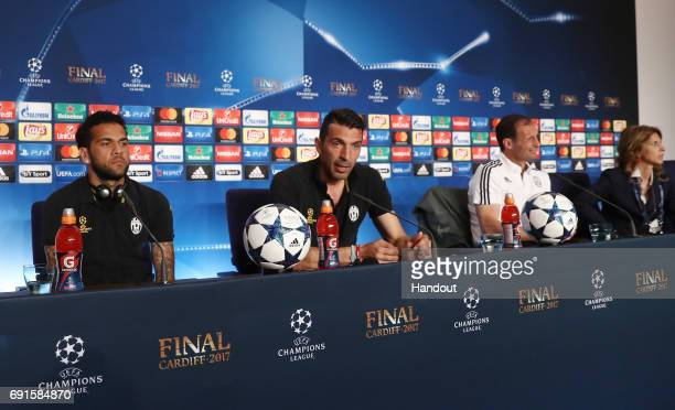 In this handout image provided by UEFA Gianluigi Buffon of Juventus talks during a press conference as Dani Alves of Juventus and Massimiliano...