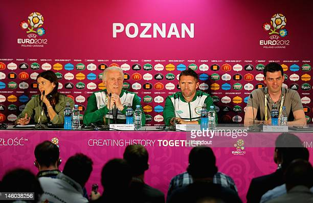 In this handout image provided by UEFA, Giovanni Trapattoni and Robbie Keane of Republic of Republic of Ireland attend a press conference during a...
