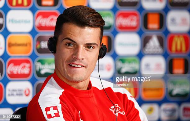 In this handout image provided by UEFA Granit Xhaka of Switzerland listens to the media during the Switzerland Press Conference at the Stade Pierre...