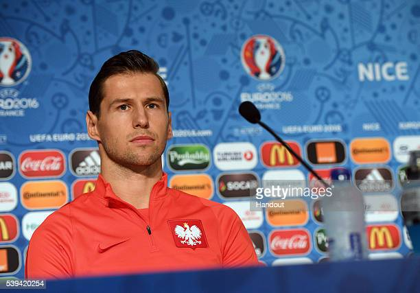 In this handout image provided by UEFA Grzegorz Krychowiak of Poland faces the media during the Poland press conference on June 11 2016 in Nice France