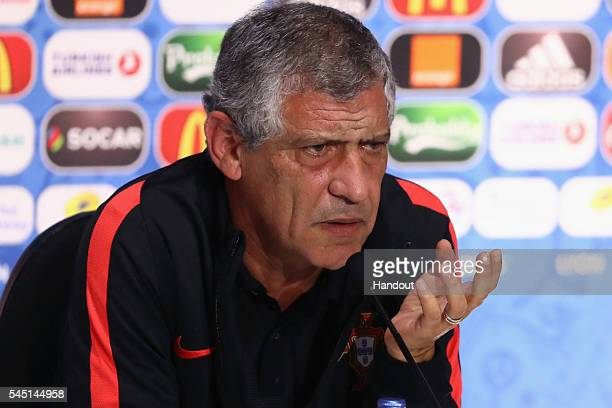 In this handout image provided by UEFA head coach Fernando Santos of Portugal attend a press conference at Stade de Lyon on July 5 2016 in Lyon France
