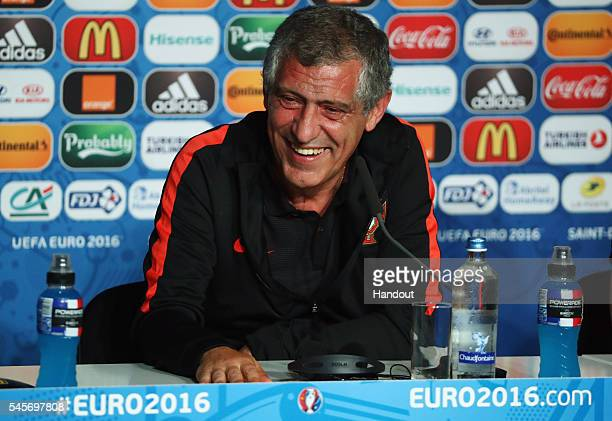 In this handout image provided by UEFA head coach Fernando Santos of Portugal attends a press conference at Stade de France on July 9 2016 in Saint...