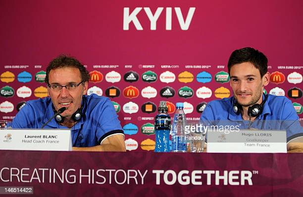 In this handout image provided by UEFA Head coach Laurent Blanc and Hugo Lloris of France talk to the media during a UEFA EURO 2012 press conference...