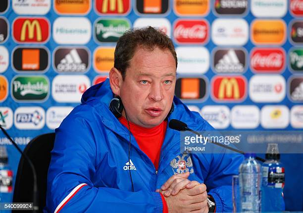 In this handout image provided by UEFA Head Coach Leonid Slutski of Russia talks to the media during the Russia Press Conference at the Stade Pierre...
