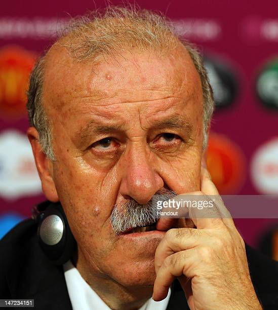 In this handout image provided by UEFA Head coach Vicente del Bosque of Spain talks to the media after the UEFA EURO 2012 Semi Final match between...