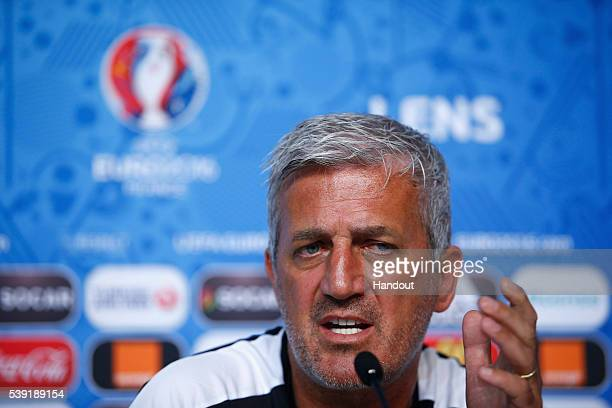 In this handout image provided by UEFA Head Coach Vladimir Petkovic of Switzerland talks to the media during the Switzerland Press Conference at the...