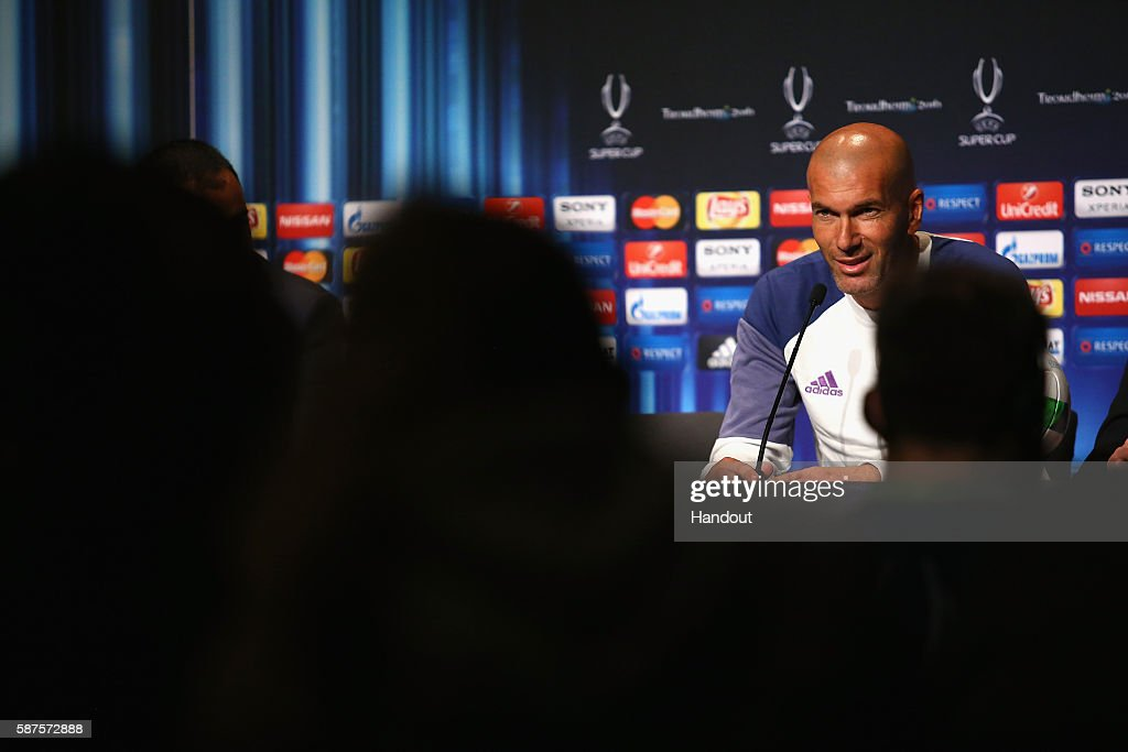In this handout image provided by UEFA, Head Coach Zinedan Zidane talks to the media during the Real Madrid Press Conference at Lerkendal Stadion on August 8, 2016 in Trondheim, Norway.