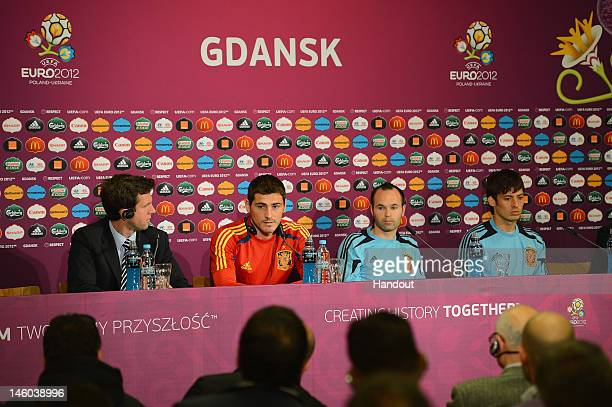 In this handout image provided by UEFA Iker Casillas Andres Iniesta and David Silva of Spain talk to the media during a UEFA EURO 2012 press...