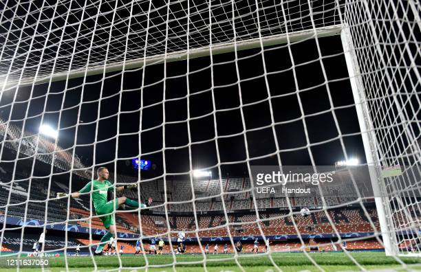 In this handout image provided by UEFA Jasper Cillessen of Valencia clears the ball during the UEFA Champions League round of 16 second leg match...