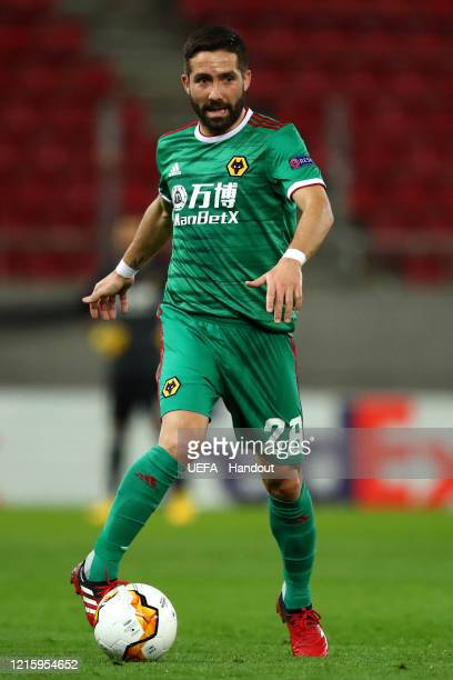 In this handout image provided by UEFA Joao Moutinho of Wolverhampton Wanderers in action during the UEFA Europa League round of 16 first leg match...