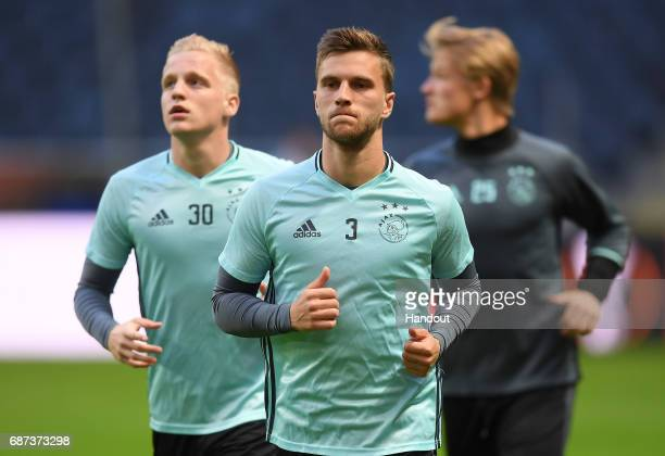 In this handout image provided by UEFA Joel Veltman of Ajax warms up during a training session at The Friends Arena ahead of the UEFA Europa League...