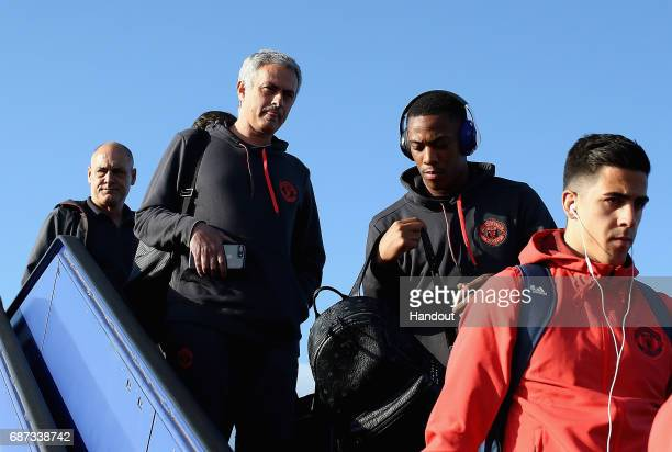 In this handout image provided by UEFA Jose Mourinho Manager of Manchester United and Anthony Martial of Manchester United arrive ahead of the UEFA...