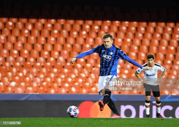 In this handout image provided by UEFA Josip Ilicic of Atalanta scores his teams second goal from the penalty spot during the UEFA Champions League...