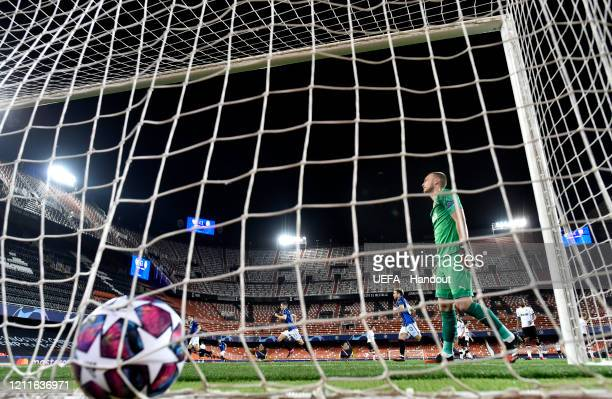 In this handout image provided by UEFA Josip Ilicic of Atalanta scores his teams second goal as Jasper Cillessen of Valencia reacts during the UEFA...